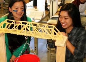 Two Girls Smiling at Pasta Bridge