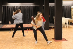 Students practicing their fight scenes